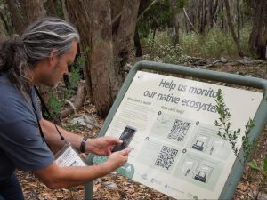 Scanning a QR code on a nature trial
